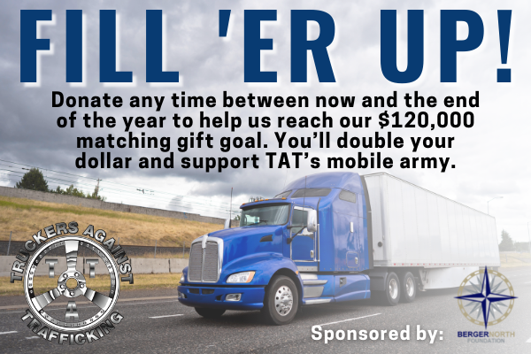 """Blue semi truck with white trailer is driving on a road with the words """"Fill 'Er Up!' and information about a matching donation above it"""